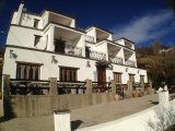 Hotel, restaurant and apartments with views in Sierra Nevada.